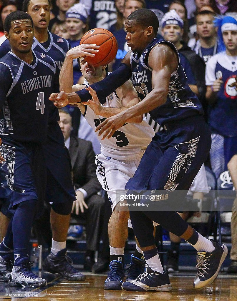 Alex Barlow #3 of the Butler Bulldogs has the ball tied up by Aaron Bowen #23 of the Georgetown Hoyas at Hinkle Fieldhouse on January 11, 2014 in Indianapolis, Indiana. Georgetown defeated Butler 70-67.