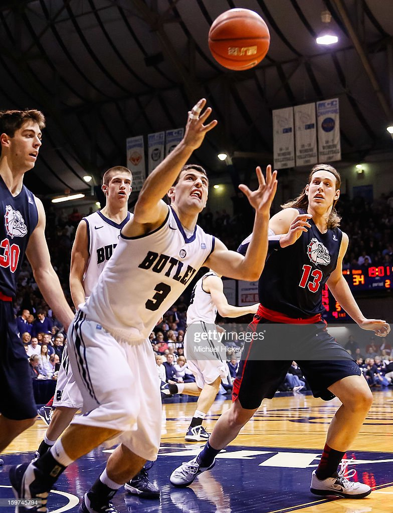 Alex Barlow #3 of the Butler Bulldogs watches a loose ball as Kelly Olynyk #13 of the Gonzaga Bulldogs looks on at Hinkle Fieldhouse on January 19, 2013 in Indianapolis, Indiana. Butler defeated Gonzaga 64-63.