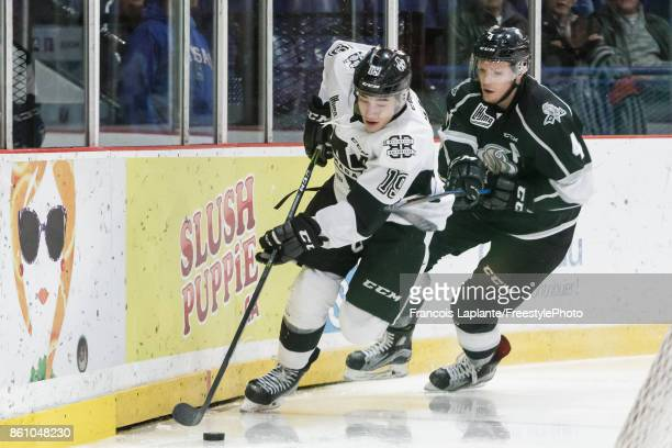 Alex BarreBoulet of the BlainvilleBoisbriand Armada controls the puck against Will Thompson of the Gatineau Olympiques on October 13 2017 at Robert...