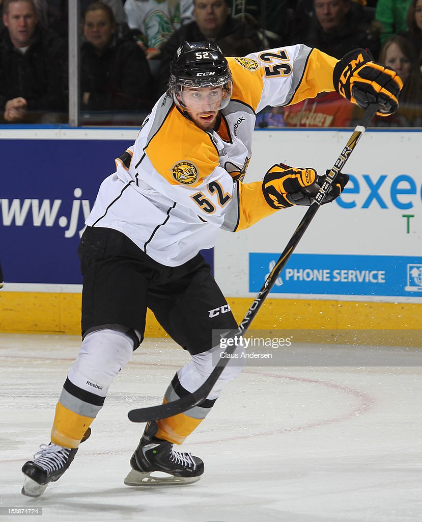 Alex Basso #52 of the Sarnia Sting makes a pass in an OHL game against the London Knights on January 1, 2013 at the Budweiser Gardens in London, Canada. The Sting defeated the Knights 6-5 in overtime to snap London's 24 game winning streak.