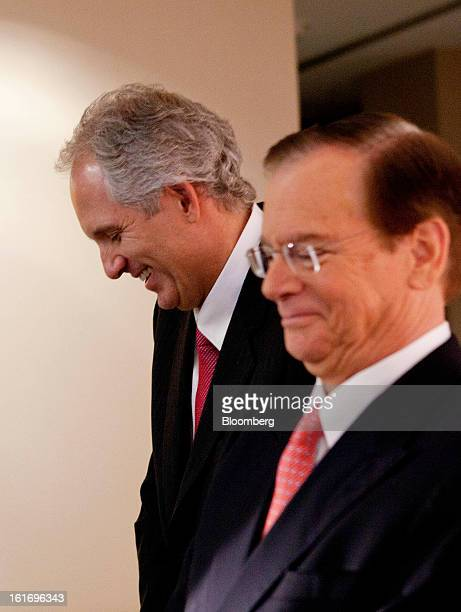 Alex Behring managing partner at 3G Capital left and Bill Johnson chief executive officer of HJ Heinz Co share a laugh during a press conference at...