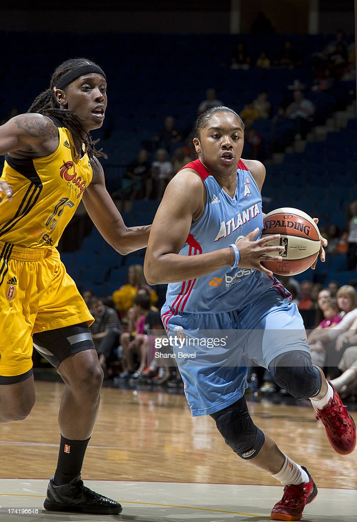 Alex Bentley #2 of the Atlanta Dream drives against <a gi-track='captionPersonalityLinkClicked' href=/galleries/search?phrase=Roneeka+Hodges&family=editorial&specificpeople=233655 ng-click='$event.stopPropagation()'>Roneeka Hodges</a> #15 of the Tulsa Shock during the WNBA game on July 21, 2013 at the BOK Center in Tulsa, Oklahoma.