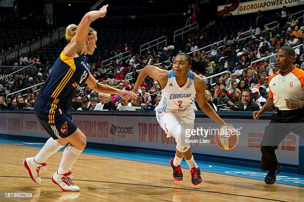 Alex Bentley of the Atlanta Dream drives around Erin Phillips of the Indiana Fever during the first half at Philips Arena on September 26 2013 in...