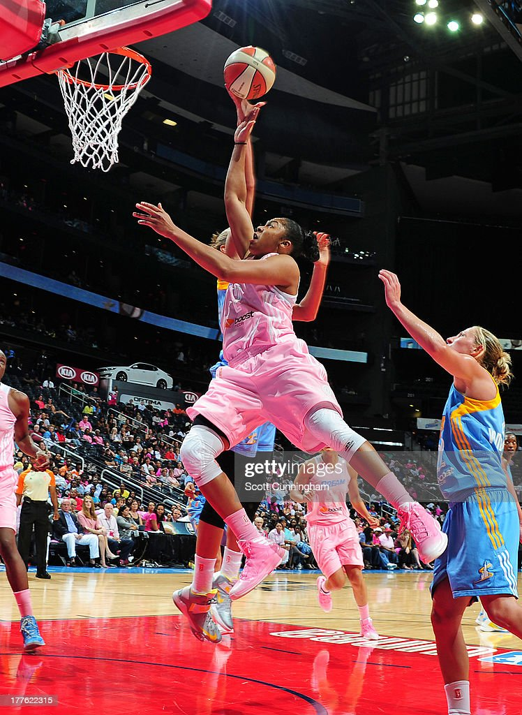 Alex Bentley #2 of the Atlanta Dream puts up a shot against Elena Delle Donne #11 of the Chicago Sky at Philips Arena on August 24 2013 in Atlanta, Georgia.