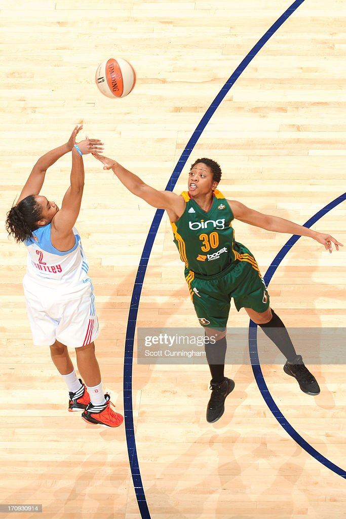 Alex Bentley #2 of the Atlanta Dream shoots over <a gi-track='captionPersonalityLinkClicked' href=/galleries/search?phrase=Tanisha+Wright&family=editorial&specificpeople=541423 ng-click='$event.stopPropagation()'>Tanisha Wright</a> #30 of the Seattle Storm at Philips Arena on June 14, 2013 in Atlanta, Georgia.