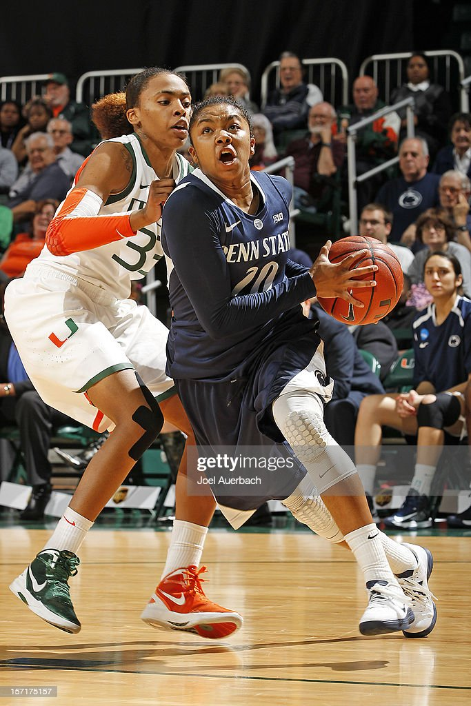 Alex Bentley #20 of the Penn State Lady Lions drives to the basket against Suriya McGuire #33 of the Miami Hurricanes on November 29, 2012 at the BankUnited Center in Coral Gables, Florida. Miami defeated Penn State 69-65.