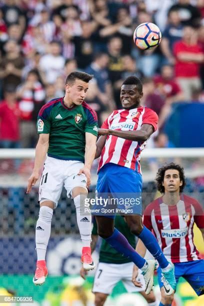Alex Berenguer Remiro of Osasuna and Thomas Teye Partey of Atletico de Madrid in action during the La Liga match between Atletico de Madrid vs...