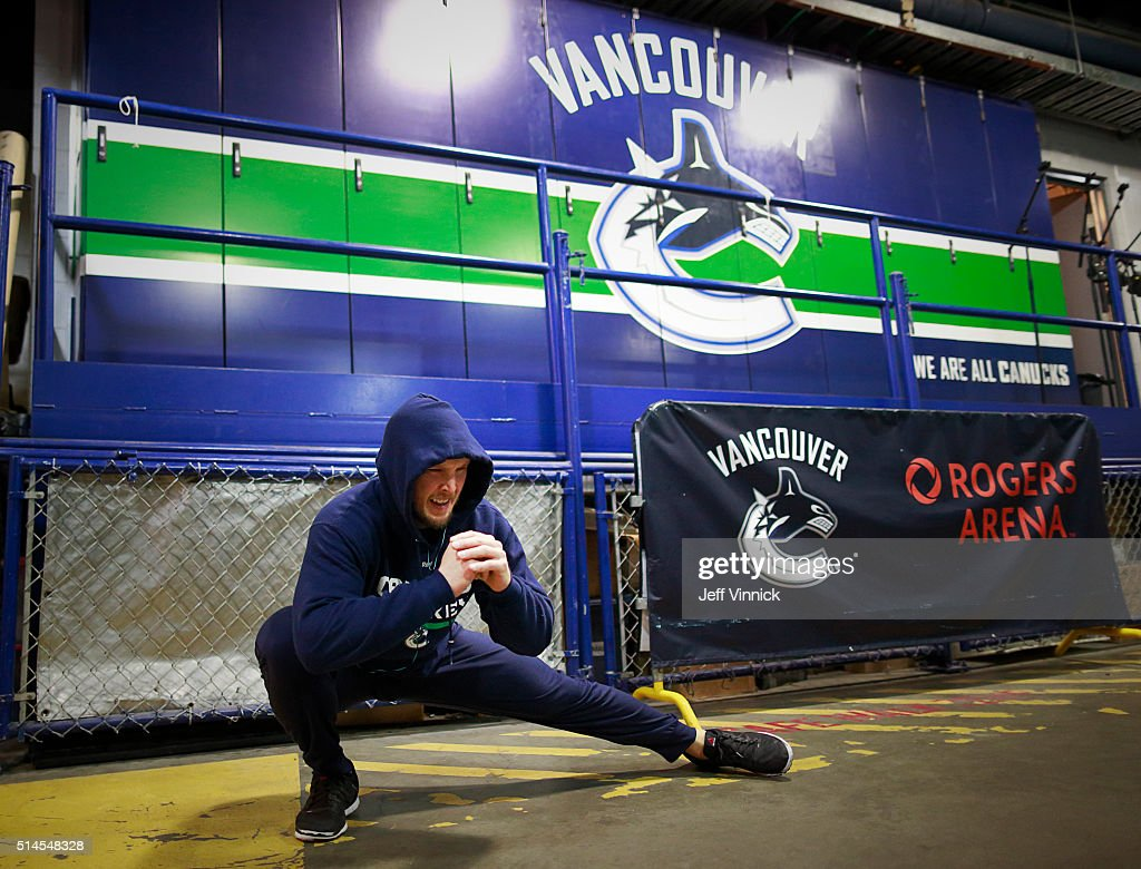 Alex Biega #55 of the Vancouver Canucks stretches before their NHL game against the Arizona Coyotes at Rogers Arena March 9, 2016 in Vancouver, British Columbia, Canada.