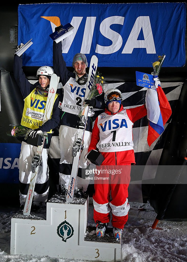Alex Bilodeau of Canada, Mikael Kingsbury of Canada, and Alexandr Smyshlyaev of Russia take the podium following the finals for the Mens 2014 FIS Freestyle Ski World Cup Mogul Competition at Deer Valley on January 11, 2014 in Park City, Utah.