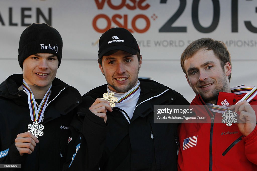 Alex Bilodeau (C) of Canada takes 1st place, Mikael Kingsbury (L) of Canada takes 2nd place, and Patrick Deneen of the USA takes 3rd place during the FIS Freestyle Ski World Championship Men's and Women's Dual Moguls on March 08, 2013 in Voss, Norway.
