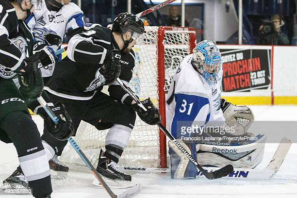 Alex Bishop of the Saint John Sea Dogs makes a save against Yan Pavel Laplante of the Gatineau Olympiques on October 18 2015 at Robert Guertin Arena...