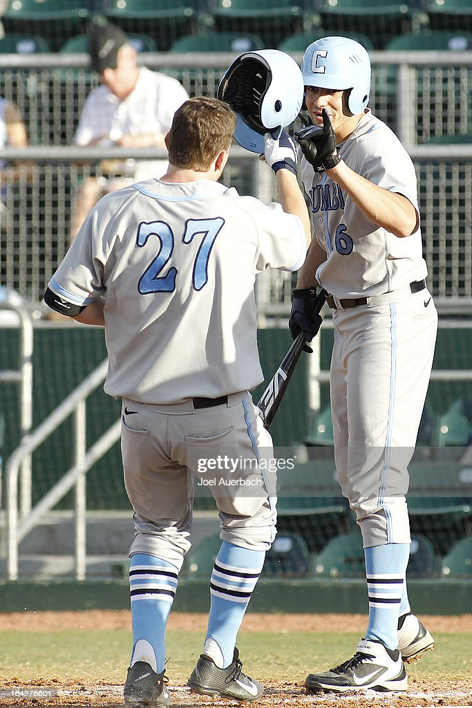 Alex Black #27 is congratulated by Nick Ferraresi #6 of the Columbia Lions after he hit a second inning solo home run against the Miami Hurricanes on March 19, 2013 at Alex Rodriguez Park at Mark Light Field in Coral Gables, Florida. Miami defeated Columbia 9-6.