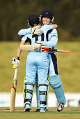 Alex Blackwell and Alyssa Healy of the Breakers celebrate victory after during the WT20 match between New South Wales Breakers and ACT Meteors at...