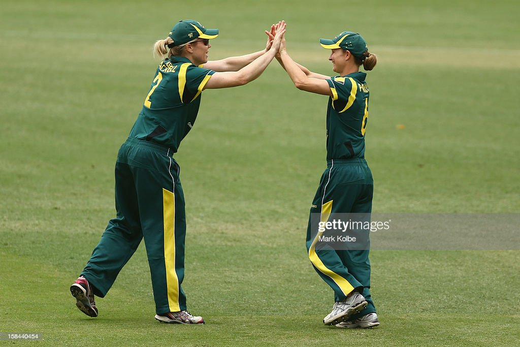 Alex Blackwell and Leah Poulton of Australia celebrate after Poulton ran out Erin Bermingham of New Zealand during game three of the One Day International series between the Australian Southern Stars and New Zealand at North Sydney Oval on December 17, 2012 in Sydney, Australia.