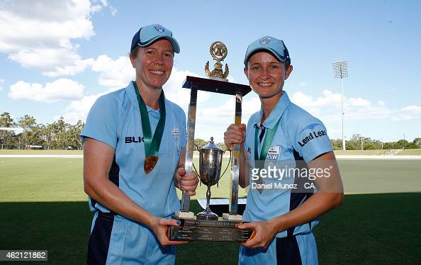 Alex Blackwell and Leah Poulton of the Breakers pose their trophy after winning the WNCL Final match between South Australia and New South Wales at...