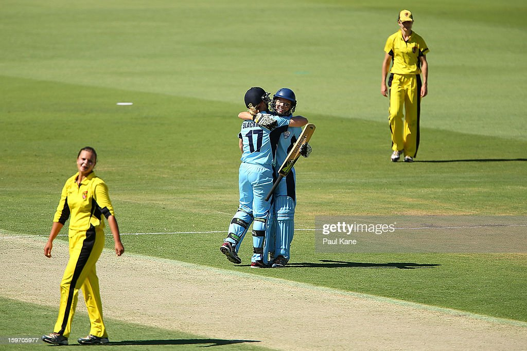 Alex Blackwell and Nicola Carey of the Breakers celebrate winning the women's Twenty20 final match between the NSW Breakers and the Western Australia Fury at WACA on January 19, 2013 in Perth, Australia.