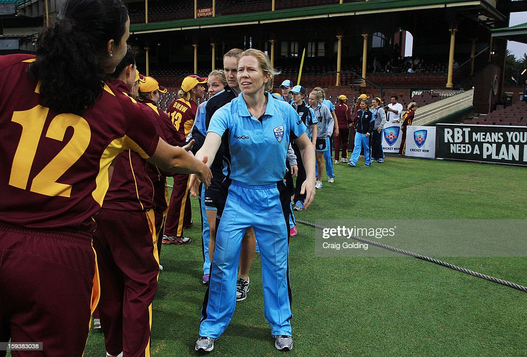 Alex Blackwell and the Breakers shake hands with the Fire players at after play was called off due to rain during the WNCL Final match between the NSW Breakers and the Queensland Fire at the Sydney Cricket Ground on January 13, 2013 in Sydney, Australia.