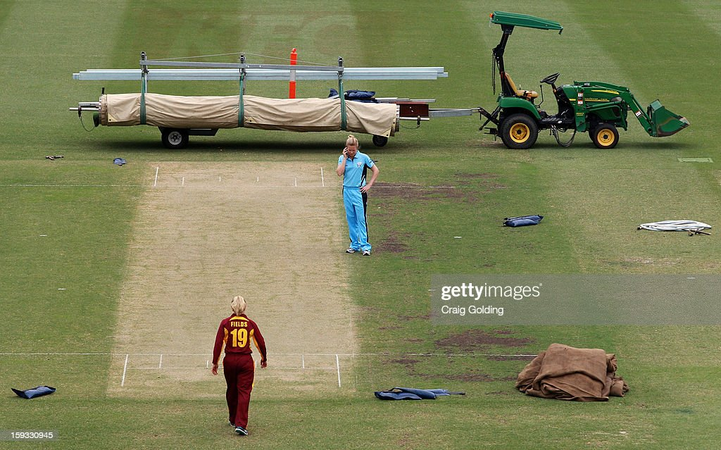Alex Blackwell ,captain of NSW and Jodie Fields, captain of Queensland, check the pitch ahead of tomorrow's WNCL one day final between the NSW Breakers and the Queensland Fire, at the Sydney Cricket Ground on January 12, 2013 in Sydney, Australia.