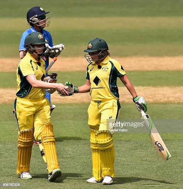Alex Blackwell of Australia and Alyssa Healy of Australia walk off the field during the women's Twenty20 International match between Australia and...