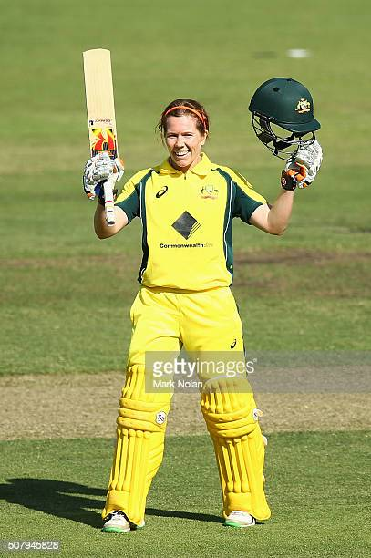 Alex Blackwell of Australia celebrates her century during game one of the Women's ODI series between Australia and India at Manuka Oval on February 2...