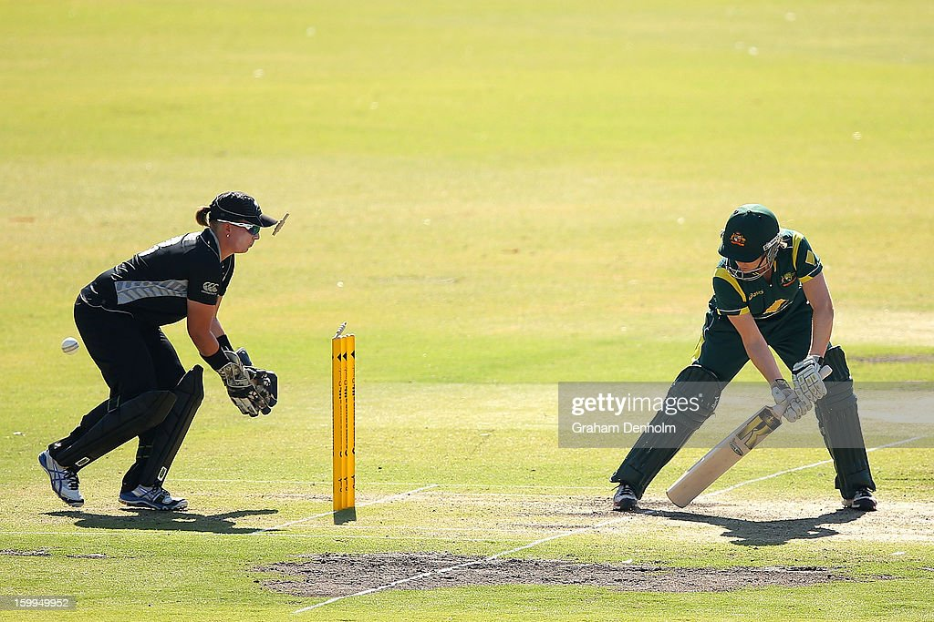 Alex Blackwell of Australia (R) is bowled out by Amy Satterthwaite of New Zealand during the Women's International Twenty20 match between the Australian Southern Stars and New Zealand at Junction Oval on January 24, 2013 in Melbourne, Australia.