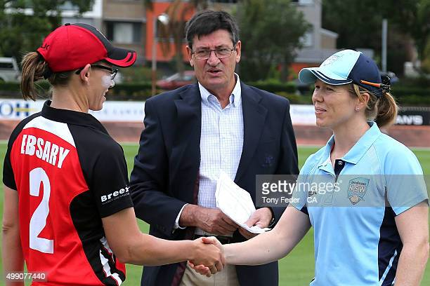 Alex Blackwell of NSW Breakers and Lauren Ebsary of SA Scorpians shake hands before the start of the game during the WNCL Final match between the New...