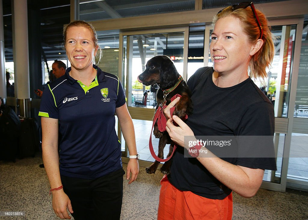 Alex Blackwell (L) of the Australian women's cricket team is greeted by her twin sister Kate Blackwell (R) after arriving home following their win in the 2013 World Cup at Sydney International Airport on February 21, 2013 in Sydney, Australia.