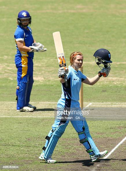 Alex Blackwell of the Breakers celebrates scoring a century during the WNCL match between the ACT Meteors and New South Wales Breakers at Manuka Oval...
