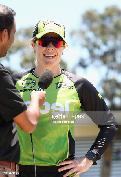 Alex Blackwell of the Sydney Thunder speaks after completing the coin toss during the Women's Big Bash League match between the Sydney Thunder and...