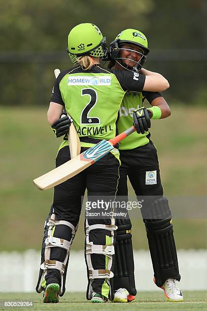Alex Blackwell of the Thunder and Harmanpreet Kaur celebrate victory during the WBBL match between the Melbourne Renegades and Sydney Thunder at...