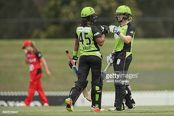 Alex Blackwell of the Thunder and Harmanpreet Kaur touch gloves during the WBBL match between the Melbourne Renegades and Sydney Thunder at Blacktown...