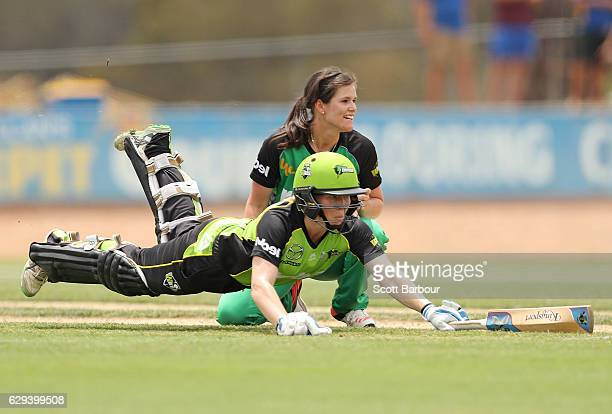Alex Blackwell of the Thunder dives to make her crease as she runs between the wickets as she bats during the Women's Big Bash League match between...