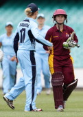 Alex Blackwell shakes hands with century maker Jodie Fields at the end of the Fire innings during the WNCL Final match between the NSW Breakers and...