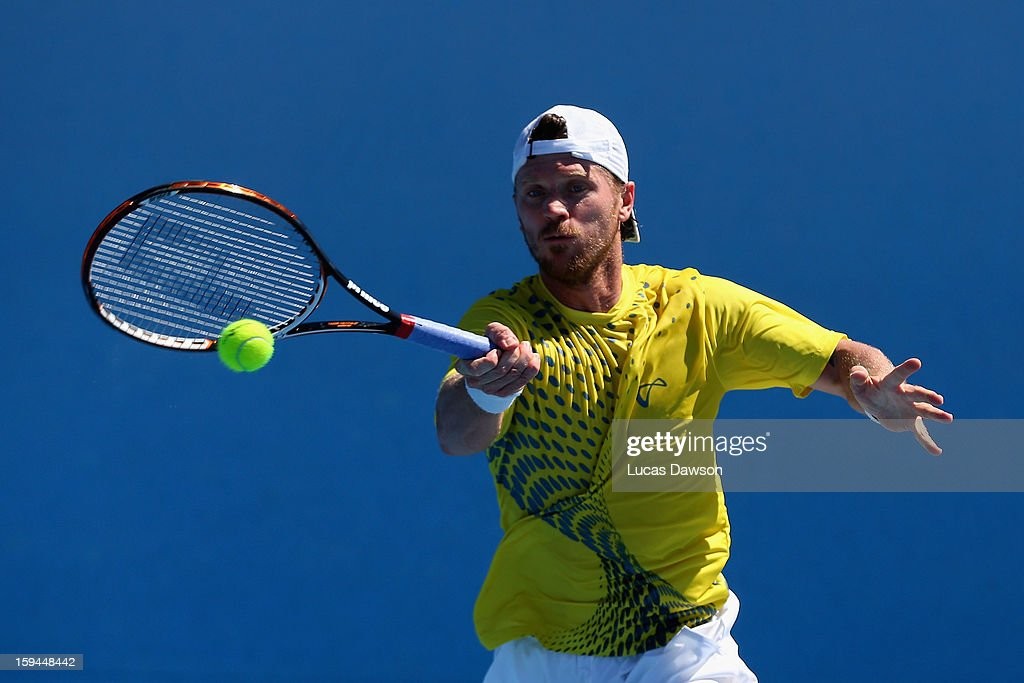 Alex Bogomolov Jr. of Russia plays a forehand in his first round match against Brian Baker of the United States of America during day one of the 2013 Australian Open at Melbourne Park on January 14, 2013 in Melbourne, Australia.