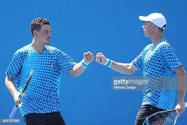 Alex Bolt and Andrew Whittington of Australia celebrate in their first round match against Gilles Muller of Luxembourg and Mahesh Bhupathi of India...
