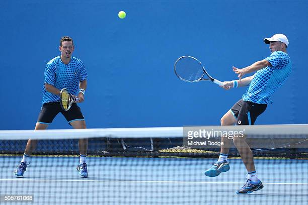 Alex Bolt and Andrew Whittington of Australia compete in their first round match against Gilles Muller of Luxembourg and Mahesh Bhupathi of India...