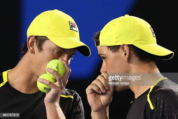 Alex Bolt and Andrew Whittington of Australia talk before their serve in their quarter final match against Daniel Nestor of Canada and Nenad Zimonjic...