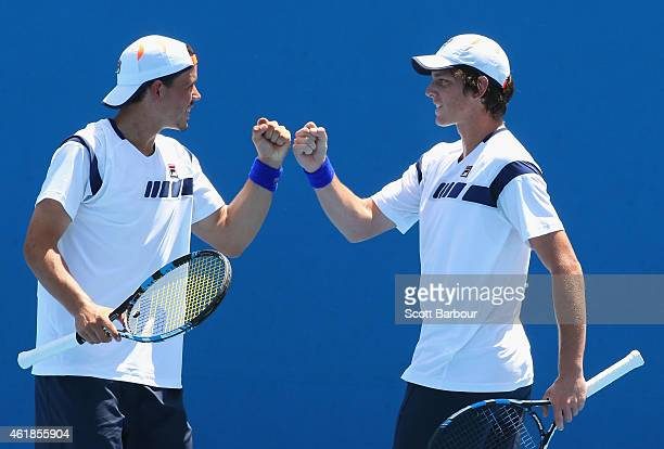 Alex Bolt of Australia and Andrew Whittington of Australia talk tactics in their first round doubles match against Marin Draganja of Croatia and...