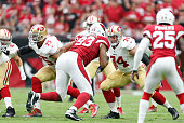 Alex Boone and Joe Staley of the San Francisco 49ers block during the game against the Arizona Cardinals at the University of Phoenix Stadium on...