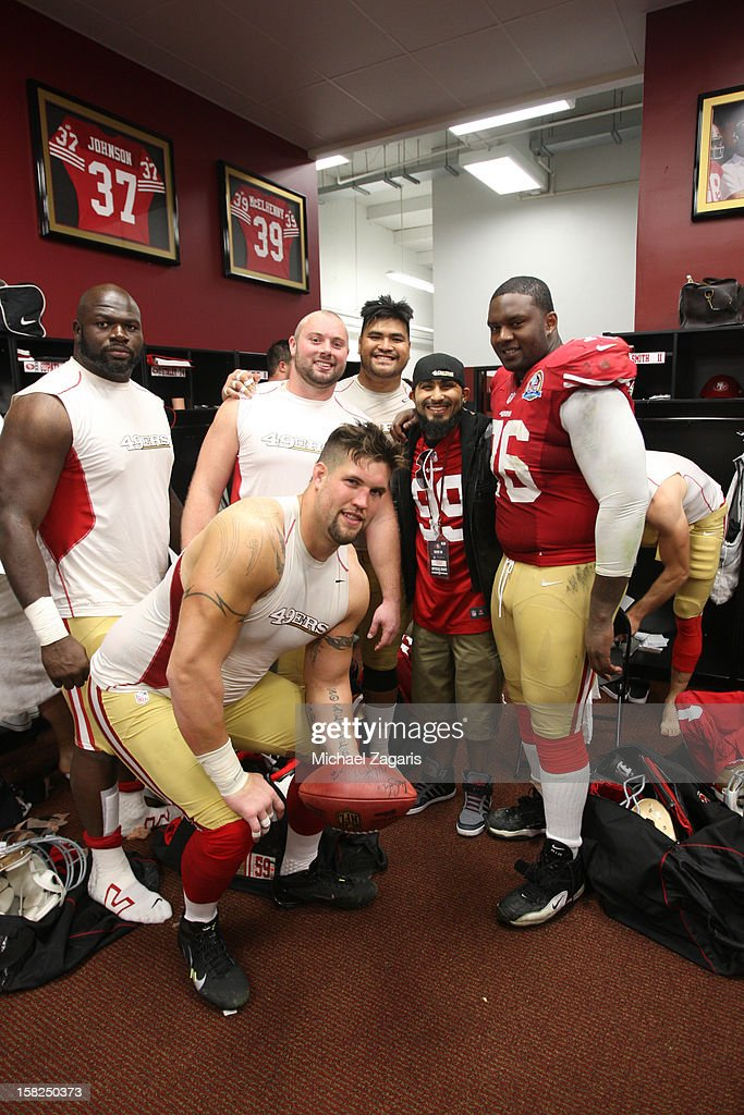 Alex Boone #75, Leonard Davis #68, Daniel Kilgore #67, Mike Iupati #77 and Anthony Davis #76 of the San Francisco 49ers stand in the locker room with Sergio romo of the San Francisco Giants following the game against the Miami Dolphins at Candlestick Park on December 9, 2012 in San Francisco, California. The 49ers defeated the Dolphins 27-13.