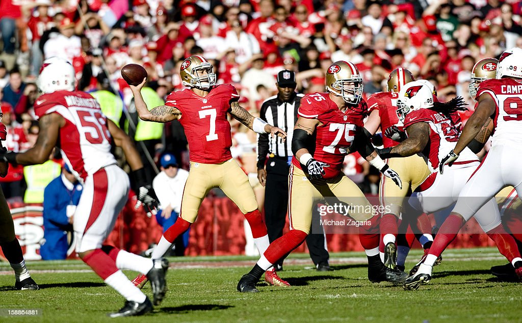Alex Boone #75 of the San Francisco 49ers blocks as Colin Kaepernick #7 passes during the game against the Arizona Cardinals at Candlestick Park on December 30, 2012 in San Francisco, California. The 49ers defeated the Cardinals 27-13.