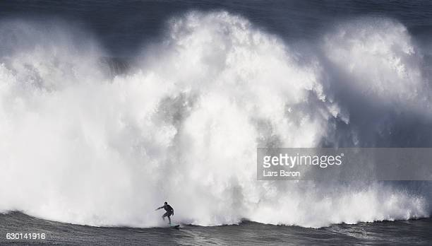 Alex Botelho of Portugal rides a wave during a big wave session at Praia do Norte on December 17 2016 in Nazare Portugal