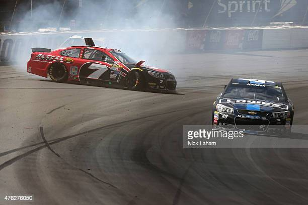Alex Bowman driver of the Accell Construction Chevrolet is involved in an ontrack incident during the NASCAR Sprint Cup Series Axalta 'We Paint...