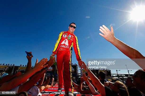 Alex Bowman driver of the Axalta Chevrolet greets fans as he is introduced during prerace ceremonies for the NASCAR Sprint Cup Series Ford EcoBoost...