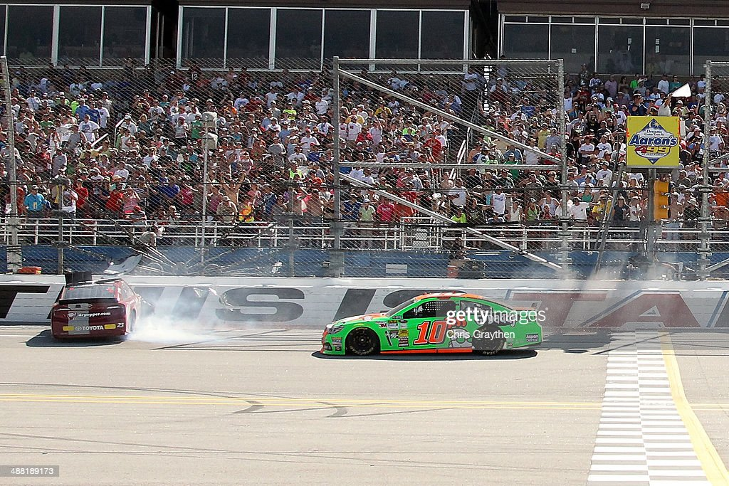 Alex Bowman, driver of the #23 Dr. Pepper Toyota, and Danica Patrick, driver of the #10 GoDaddy.com Chevrolet, are involved in an incident at the end of the NASCAR Sprint Cup Series Aaron's 499 at Talladega Superspeedway on May 4, 2014 in Talladega, Alabama.