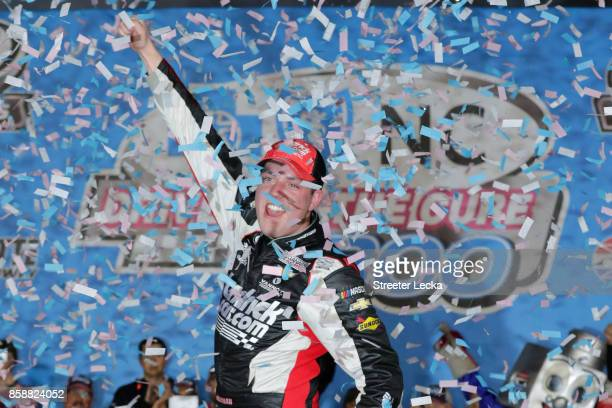 Alex Bowman driver of the HendrickCarscom Chevrolet celebrates in victory lane after winning the NASCAR XFINITY Series Drive for the Cure 300...