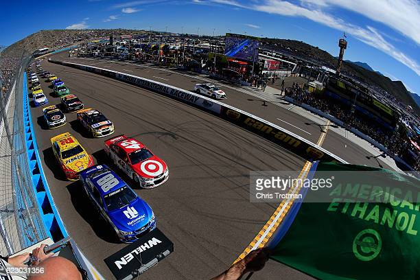 Alex Bowman driver of the Nationwide Chevrolet leads the field to the green flag to start the NASCAR Sprint Cup Series CanAm 500 at Phoenix...