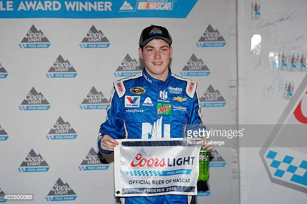 Alex Bowman driver of the Nationwide Chevrolet poses with the Coors Light Pole Award after qualifying for the pole position for the NASCAR Sprint Cup...