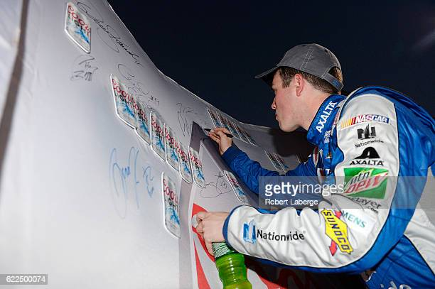 Alex Bowman driver of the Nationwide Chevrolet signs the Coors Light Pole board after qualifying for the pole position for the NASCAR Sprint Cup...