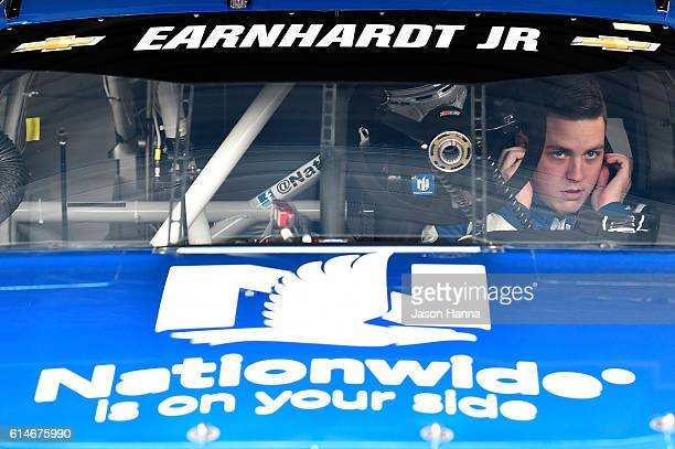 Alex Bowman driver of the Nationwide Chevrolet sits in his car during practice for the NASCAR Sprint Cup Series Hollywood Casino 400 at Kansas...